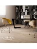 Fauteuil UNI-KA assise coque garnie de mousse avec tissu, piètement finition chromé, peint blanc ou noir.