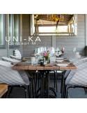 Fauteuil UNI-KA assise coque effet matelassé, piétement acier chromé, autre finition possible peint noir ou blanc.