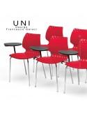 Chaise design UNI, piétement chromé, assise coque rouge avec tablette d'écriture rabattable.