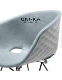 Exemple fauteuil UNI-KA, coque effet matelassé couleur, assise garnie habillage cuir ou tissu, piétement acier ou bois.