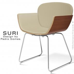 Fauteuil SURI, piétement luge, dossier placage bois naturel Noyer, assise et dossier habillage cuir Sotega, couleur beige.