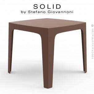 Table SOLID, pour repas ou dîner en extérieur, stucture et piétement 4 pieds en plastique couleur bronze.